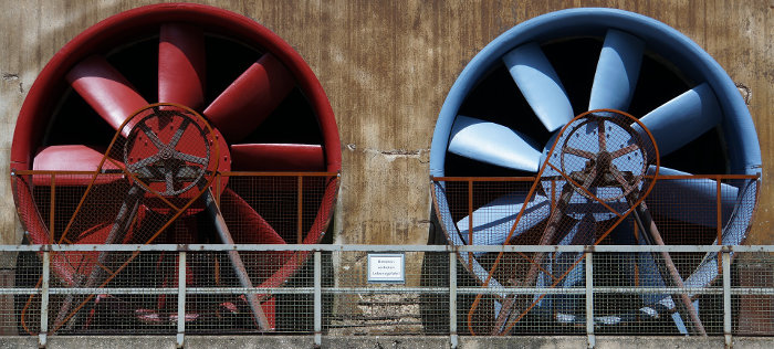 Two Industrial Air Handling Fans Painted Red and Blue
